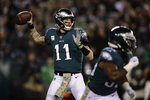 Philadelphia Eagles' Carson Wentz looks to pass during the first half of an NFL football game against the New England Patriots, Sunday, Nov. 17, 2019, in Philadelphia. (AP Photo/Matt Rourke)