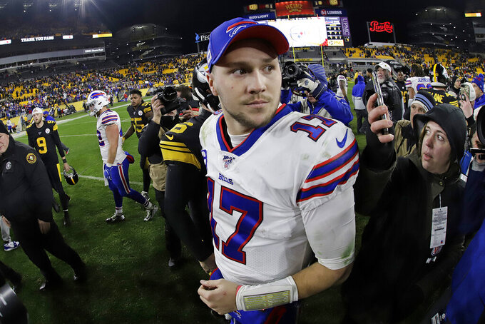 Buffalo Bills quarterback Josh Allen (17) stands on the field following an NFL football game against the Pittsburgh Steelers in Pittsburgh, Sunday, Dec. 15, 2019. The Bills won 17-10. (AP Photo/Gene J. Puskar)