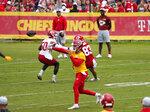 Kansas City Chiefs quarterback Patrick Mahomes, front, passes the ball during drills at the team's NFL football training camp Saturday, July 31, 2021, in St. Joseph, Mo. (AP Photo/Ed Zurga)