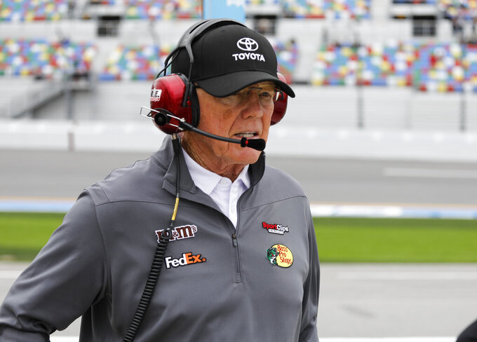 In this Sunday, Feb. 10, 2019 photo, car owner Joe Gibbs walks down pit road during qualifying for the Daytona 500 auto race at Daytona International Speedway, , in Daytona Beach, Fla. (AP Photo/Terry Renna)