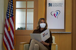 First lady Melania Trump reads from a prepared statement during a round table discussion at Concord Hospital, Thursday, Sept. 17, 2020, in Concord, N.H. (AP Photo/Mary Schwalm)