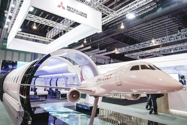 A static model of a Mitsubishi Aircraft Spacejet sits on display at the Singapore Airshow on Tuesday, Feb. 11, 2020, in Singapore. (AP Photo/Danial Hakim)