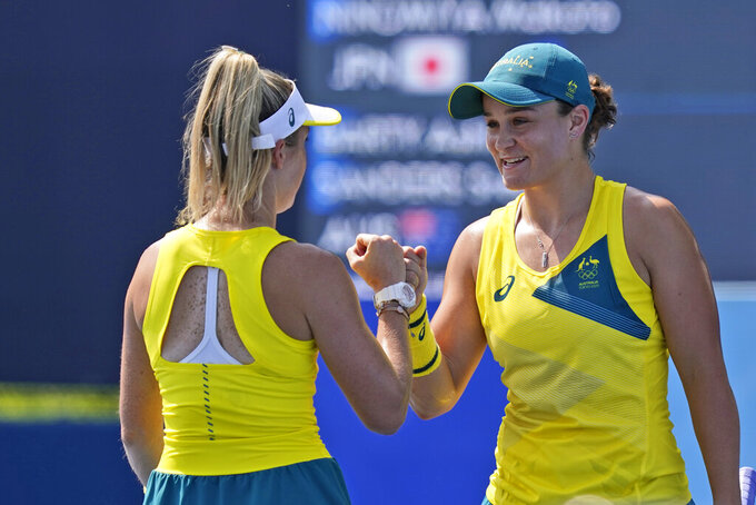 Ashleigh Barty, right, and Storm Sanders, both of Australia, play in a doubles match during the first round of the tennis competition at the 2020 Summer Olympics, Saturday, July 24, 2021, in Tokyo, Japan. (AP Photo/Seth Wenig)