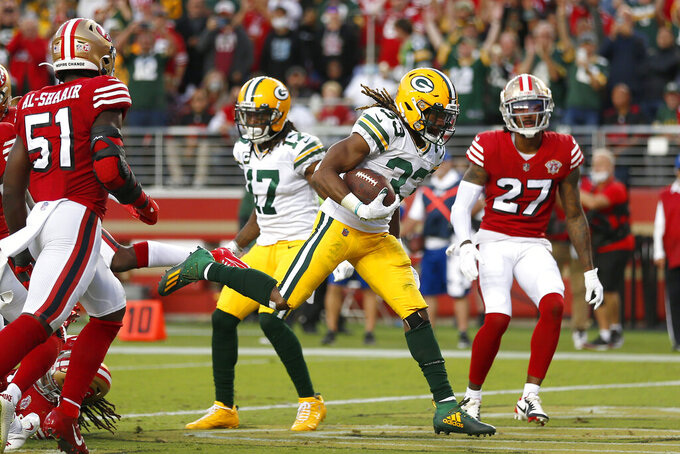 Green Bay Packers running back Aaron Jones (33) scores against the San Francisco 49ers during the first half of an NFL football game in Santa Clara, Calif., Sunday, Sept. 26, 2021. (AP Photo/Jed Jacobsohn)