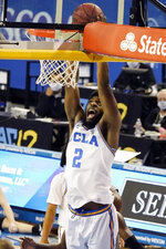 UCLA forward Cody Riley (2) dunks against Oregon State during the second half of an NCAA college basketball game Saturday, Jan. 30, 2021, in Los Angeles. (AP Photo/Marcio Jose Sanchez)