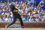 Washington Nationals' Yan Gomes hits two-run single off of Chicago Cubs' Jose Quintana during the third inning of a baseball game, Saturday, Aug. 24, 2019, in Chicago. (AP Photo/Kamil Krzaczynski)