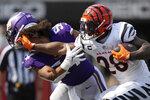 Cincinnati Bengals running back Joe Mixon (28) knocks the helmet off Minnesota Vikings middle linebacker Eric Kendricks (54) as he rushes the ball in the fourth quarter of an NFL football game Sunday, Sept. 12, 2021, in Cincinnati. (Andrew Souffle/Star Tribune via AP)