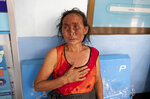 An injured Karen villager from Myanmar rests at Ban Mae Sam Laep Health Center, Mae Hong Son province, northern Thailand, after they crossed Salawin river on a boat, Tuesday March 30, 2021. The weekend strikes by the Myanmar military, which sent ethnic Karen people seeking safety in Thailand, represented another escalation in the violent crackdown by Myanmar's junta on protests of its Feb. 1 takeover.(AP Photo/Sakchai Lalit)