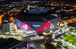 FILE-In this Friday, Sep. 21, 2018, photo, Mercedes-Benz Stadium is seen in this aerial photo in Atlanta. The stadium will be the site of Super Bowl LIII on Sunday, Feb. 3, 2019. Legions of police and federal agents will be protecting the stadium as Atlanta hosts Super Bowl 53, but recent attacks in the U.S. and around the world underscore how terrorists are striking less-secure areas outside sports stadiums, arenas and airports, experts say.(AP Photo/Danny Karnik, File)