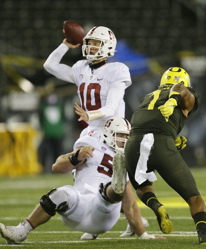 Stanford quarterback Jack West throws downfield against Oregon during the third quarter of an NCAA college football game Saturday, Nov. 7, 2020, in Eugene, Ore. (AP Photo/Chris Pietsch)