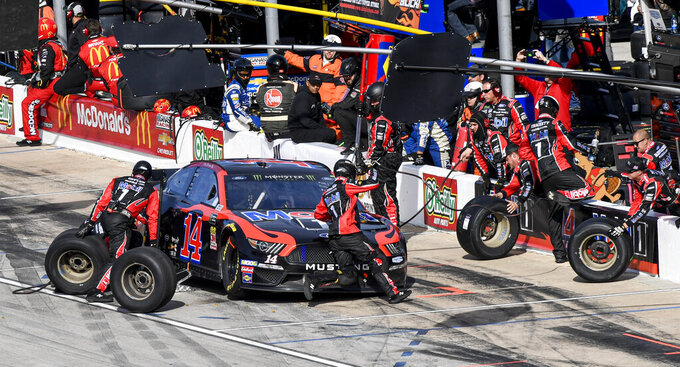 Clint Bowyer's pit crew services his car during a NASCAR auto race at Texas Motor Speedway, Sunday, Nov. 3, 2019, in Fort Worth, Texas. (AP Photo/Larry Papke)