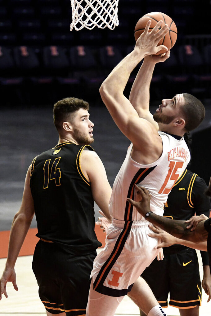 Illinois' Giorgi Bezhanishvili (15) shoots over North Carolina A&T's Harry Morrice (14) in the first half of an NCAA college basketball game Wednesday, Nov. 25, 2020, in Champaign, Ill. (Photo/Holly Hart)