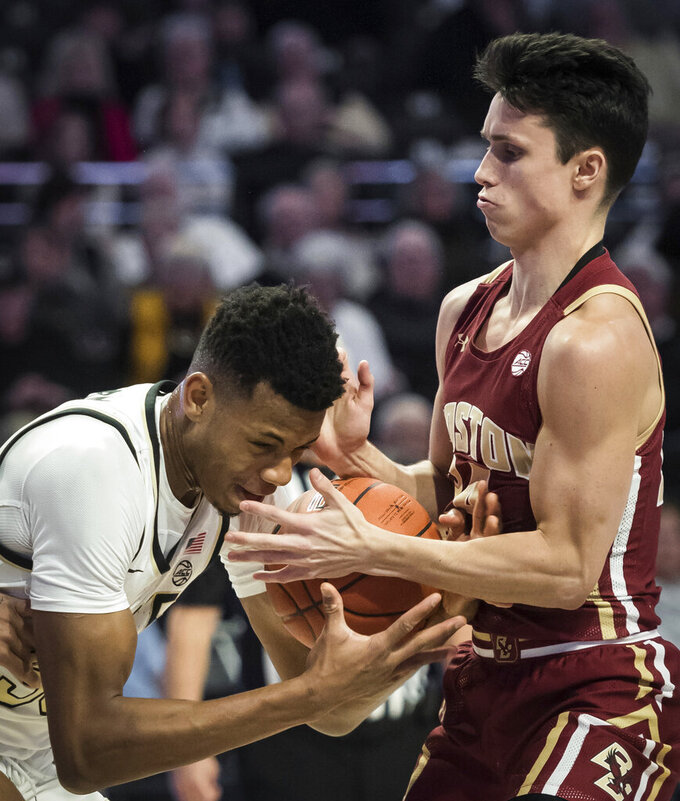 Wake Forest forward Ody Oguama (33) and Boston College guard Chris Herren Jr. (24) vie for the ball in the first half of an ACC college basketball game on Sunday, Jan. 19, 2020, at Joel Coliseum in Winston-Salem, N.C. (Allison Lee Isley/Winston-Salem Journal via AP)
