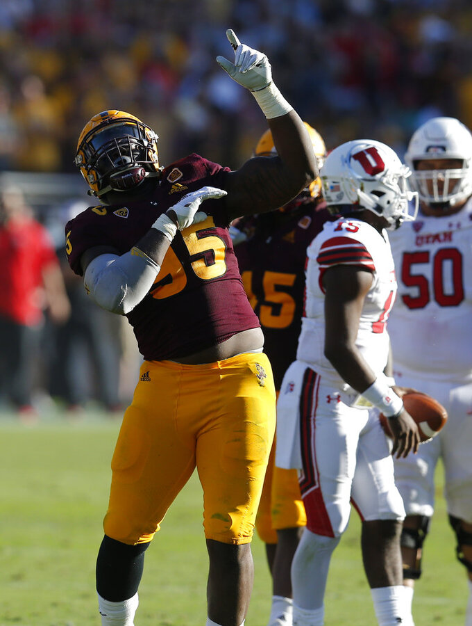 Arizona State defensive lineman Renell Wren (95) celebrates after sacking Utah quarterback Jason Shelley (15) in the second half of an NCAA college football game, Saturday, Nov. 3, 2018, in Tempe, Ariz. (AP Photo/Rick Scuteri)