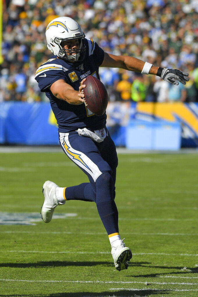Los Angeles Chargers quarterback Philip Rivers runs for the sideline during the first half of an NFL football game against the Green Bay Packers Sunday, Nov. 3, 2019, in Carson, Calif. (AP Photo/Mark J. Terrill)