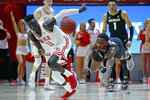Utah guard Both Gach (11) and Colorado guard McKinley Wright IV, right, go after a loose ball in the second half during an NCAA college basketball game Saturday, March 7, 2020, in Salt Lake City. (AP Photo/Rick Bowmer)