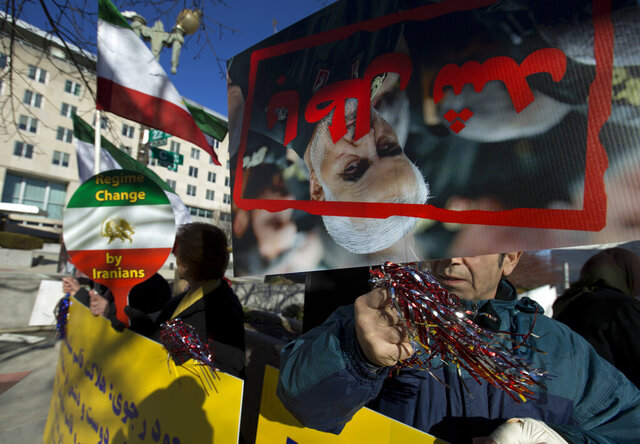 ADDS THAT THE PEOPLE AT THE RALLY ARE SUPPORTERS OF THE MUJAHEDEEN-E-KHALQ - Members of the Iranian American community of Washington, D.C., who support the Mujahedeen-e-Khalq, or the MeK, an Iranian exile group that seeks to overthrow Iran's government, rally outside the State Department in Washington, Monday, Jan. 6, 2020. Participants at the rally celebrated the death of Iranian Gen. Qassem Soleimani, who was killed by a U.S. airstrike in Iraq. (AP Photo/Jose Luis Magana)