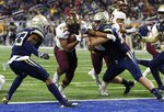 Minnesota running back Mohamed Ibrahim (24) breaks through the Georgia Tech defense for a 3-yard touchdown during the second half of the Quick Lane Bowl NCAA college football game Wednesday, Dec. 26, 2018, in Detroit. (AP Photo/Carlos Osorio)