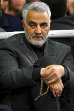 FILE - In this March 27, 2015 file photo released by an official website of the office of the Iranian supreme leader, commander of Iran's Quds Force, Qassem Soleimani, sits in a religious ceremony at a mosque in the residence of Supreme Leader Ayatollah Ali Khamenei in Tehran, Iran. As Iran's frontman in Syria since 2011, Soleimani helped turn the tide in the now 9-year-old civil war, intervening to save Assad as armed rebels reached the capital Damascus and seized several key cities. (Office of the Iranian Supreme Leader via AP, File)