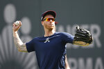 Atlanta Braves starting pitcher Mike Foltynewicz (26) throws in the outfield during a team workout Tuesday, Oct. 8, 2019, in Atlanta. Foltynewicz is scheduled to start for the Braves when face the St. Louis Cardinals in Game 5 of the NLCS Wednesday in Atlanta. (AP Photo/John Bazemore)