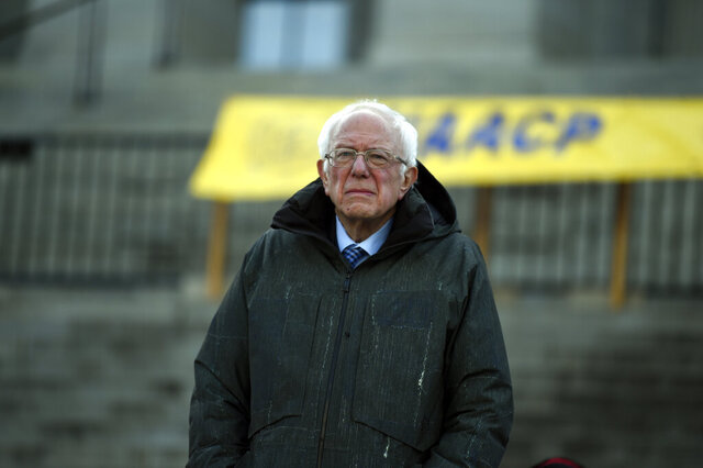 Democratic presidential candidate Sen. Bernie Sanders, I-Vt., stands at the South Carolina Statehouse before a Dr. Martin Luther King Jr. Day rally Monday, Jan. 20, 2020, in Columbia, S.C. (AP Photo/Meg Kinnard)