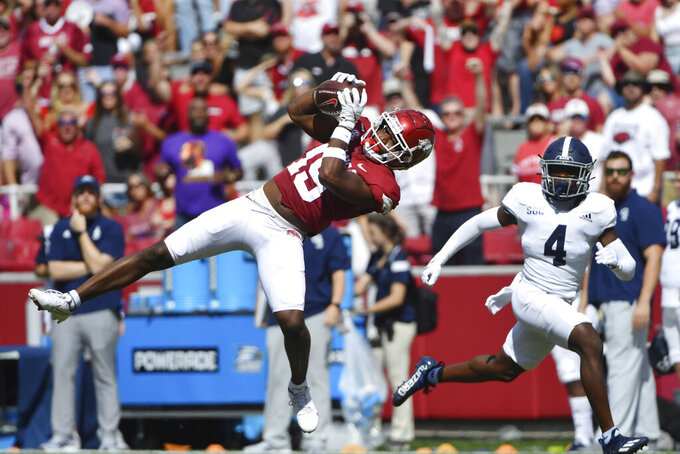 Arkansas receiver Tyson Morris (19) makes a catch in front of Georgia Southern defender Gerald Green (4) during the first half of an NCAA college football game Saturday, Sept. 18, 2021, in Fayetteville, Ark. (AP Photo/Michael Woods)