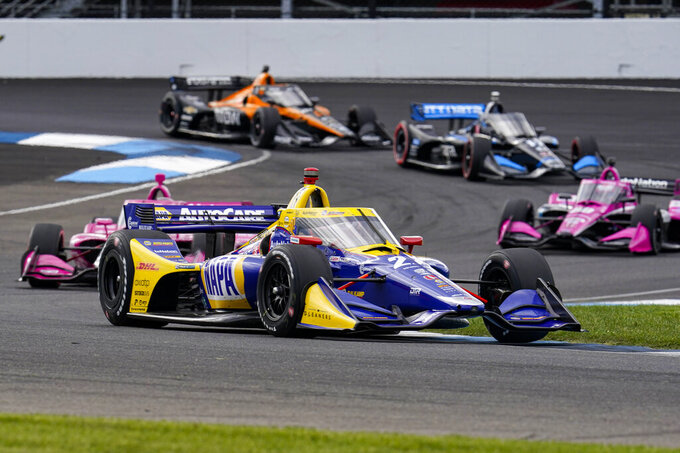 Alexander Rossi drives through a turn during an IndyCar auto race at Indianapolis Motor Speedway in Indianapolis, Friday, Oct. 2, 2020. (AP Photo/Michael Conroy)