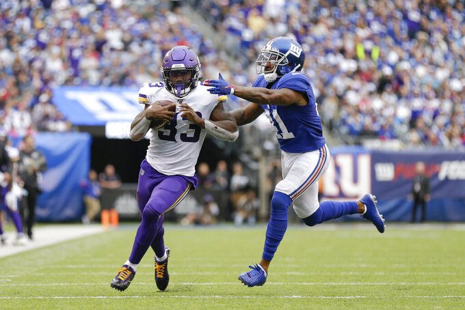 Minnesota Vikings running back Dalvin Cook (33) tries to avoid a tackle by New York Giants free safety Antoine Bethea (41) during the third quarter of an NFL football game, Sunday, Oct. 6, 2019, in East Rutherford, N.J. (AP Photo/Adam Hunger)