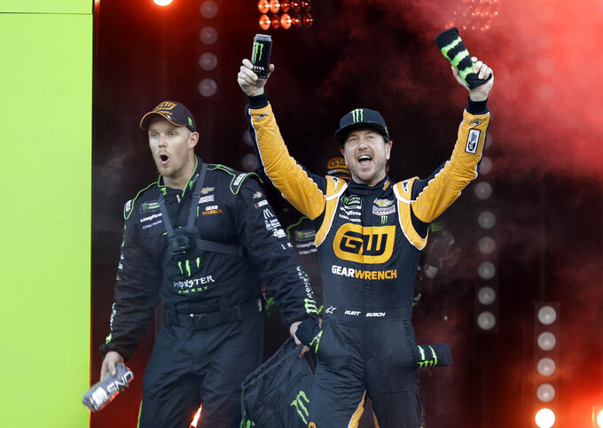 Kurt Busch, right, is introduced before the NASCAR All-Star Race at Charlotte Motor Speedway in Concord, N.C., Saturday, May 18, 2019. (AP Photo/Chuck Burton)