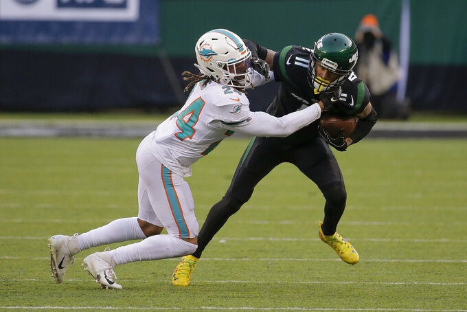 New York Jets wide receiver Robby Anderson (11) runs the ball against Miami Dolphins cornerback Ryan Lewis (24) during the fourth quarter of an NFL football game, Sunday, Dec. 8, 2019, in East Rutherford, N.J. (AP Photo/Seth Wenig)