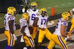 LSU wide receiver Jontre Kirklin (13) and wide receiver Racey McMath (17) celebrate after Kirklin scored a touchdown against Vanderbilt in the first half of an NCAA college football game Saturday, Oct. 3, 2020, in Nashville, Tenn. (AP Photo/Mark Humphrey)