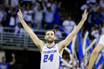 Creighton's Mitch Ballock (24) celebrates after scoring a three-point shot during the second half of an NCAA college basketball game against Seton Hall in Omaha, Neb., Saturday, March 7, 2020. Creighton won 77-60. (AP Photo/Nati Harnik)