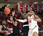 Houston's Breaon Brady (24) reaches for a rebound along with Southern Methodist's Isiaha Mike, center, and Ethan Chargois, left, during the first half of an NCAA college basketball game Thursday, March 7, 2019, in Houston. (AP Photo/David J. Phillip)