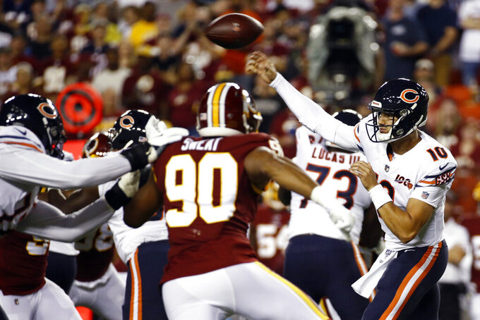 Chicago Bears quarterback Mitchell Trubisky (10) throws under pressure from Washington Redskins linebacker Montez Sweat (90) during the first half of an NFL football game Monday, Sept. 23, 2019, in Landover, Md. (AP Photo/Patrick Semansky)