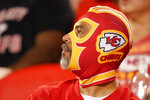 A fan is seen during the second half of an NFL football game between the Kansas City Chiefs and the Minnesota Vikings Friday, Aug. 27, 2021, in Kansas City, Mo. (AP Photo/Charlie Riedel)