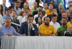 Venezuela's National Assembly President and self proclaimed interim President Juan Guaido, center, Jose Cartaya, sub Secretary of the National Assembly, left, and Edison Ferrer, secretary of the National Assembly, right, attend a meeting with regional and municipal leaders in Caracas, Venezuela, Wednesday, August 21, 2019. Guaido on Wednesday cast doubt on President Nicolas Maduro's claim that he is overseeing secret talks with the United States, saying it only reflects disarray within the Venezuelan government. (AP Photo/Leonardo Fernandez)