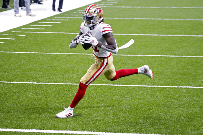 San Francisco 49ers wide receiver Brandon Aiyuk (11) crosses the goal line on a touchdown reception in the first half of an NFL football game against the New Orleans Saints in New Orleans, Sunday, Nov. 15, 2020. (AP Photo/Butch Dill)