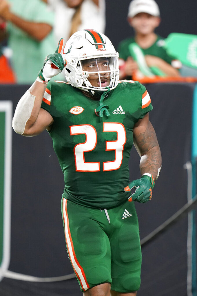 Miami running back Cam'Ron Harris celebrates after a touchdown during the second half of an NCAA college football game against Appalachian State, Saturday, Sept. 11, 2021, in Miami Gardens, Fla. (AP Photo/Wilfredo Lee)