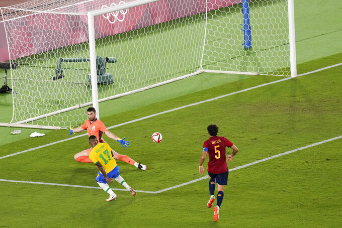 Brazil's Malcom scores his side's second goal against Spain in the men's soccer final match at the 2020 Summer Olympics, Saturday, Aug. 7, 2021, in Yokohama, Japan. (AP Photo/Martin Mejia)