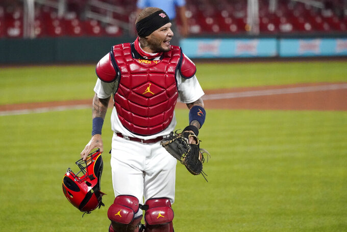 St. Louis Cardinals catcher Yadier Molina walks off the field after a ground out by Cincinnati Reds' Freddy Galvis to end the top of the sixth inning of a baseball game Thursday, Aug. 20, 2020, in St. Louis. (AP Photo/Jeff Roberson)