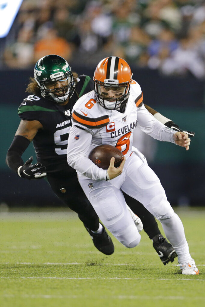 Cleveland Browns' Baker Mayfield (6) runs away from New York Jets' Leonard Williams (92) during the second half of an NFL football game Monday, Sept. 16, 2019, in East Rutherford, N.J. (AP Photo/Adam Hunger)