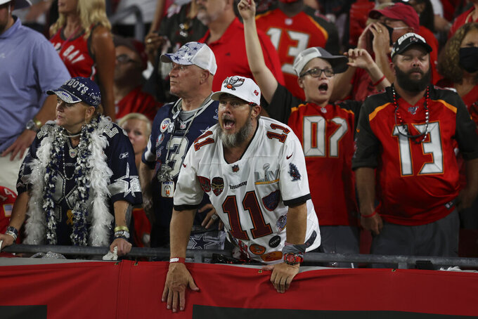 Tampa Bay Buccaneers fans cheer during the second half of an NFL football game against the Dallas Cowboys Thursday, Sept. 9, 2021, in Tampa, Fla. (AP Photo/Mark LoMoglio)
