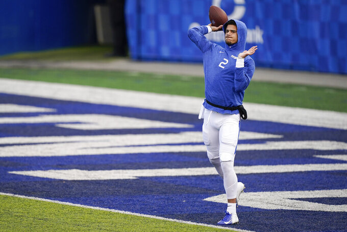 Kentucky quarterback Joey Gatewood (2) warms up before an NCAA college football game against Georgia, Saturday, Oct. 31, 2020, in Lexington, Ky. (AP Photo/Bryan Woolston)