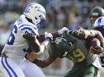 FILE - In this Sept. 15, 2018, file photo, Baylor quarterback Jalan McClendon, right, is pulled down by Duke defensive end Chris Rumph II, left during the second half of an NCAA college football game in Waco, Texas. Rumph, a fourth-year junior speed rusher, was overlooked in an Atlantic Coast Conference with lots of good defensive ends last year. His 13.5 tackles for loss and 6.5 sacks were only good enough for third-team all-ACC. (Rod Aydelotte/Waco Tribune Herald via AP, File)