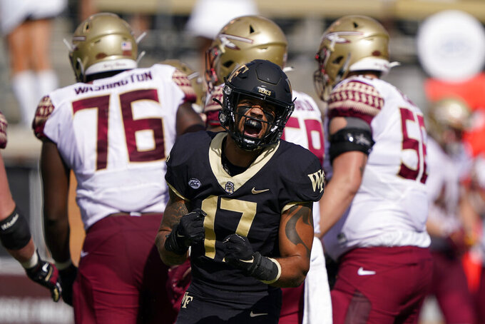 Wake Forest defensive back Traveon Redd celebrates after a tackle against Florida State during the first half of an NCAA college football game Saturday, Sept. 18, 2021, in Winston-Salem, N.C. (AP Photo/Chris Carlson)