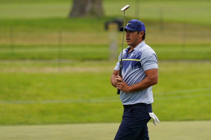 Brooks Koepka reacts after missing a putt on the sixth hole during the final round of the PGA Championship golf tournament at TPC Harding Park Sunday, Aug. 9, 2020, in San Francisco. (AP Photo/Jeff Chiu)