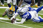 Green Bay Packers' Marquez Valdes-Scantling (83) fumbles a catch during the overtime of an NFL football game against the Indianapolis Colts, Sunday, Nov. 22, 2020, in Indianapolis. Colts' DeForest Buckner (99) recovered the fumble. (AP Photo/Michael Conroy)