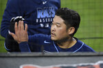 Tampa Bay Rays' Yoshitomo Tsutsugo, of Japan, celebrates his home run, at the dugout during the third inning of the team's baseball game against the Baltimore Orioles, Saturday, Sept. 19, 2020, in Baltimore. (AP Photo/Nick Wass)