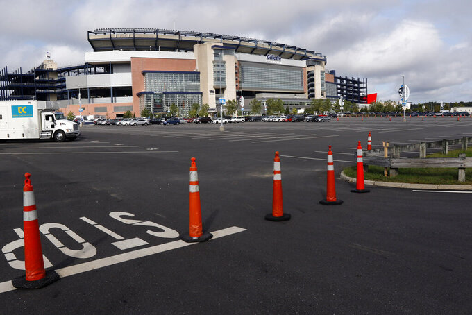 A parking lot outside Gillette Stadium is unused by tailgating fans before an NFL football game between the New England Patriots and Miami Dolphins, Sunday, Sept. 13, 2020, in Foxborough, Mass. (AP Photo/Bill Sikes)