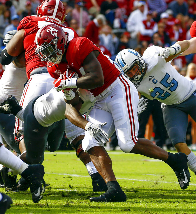 Alabama running back Brian Robinson Jr. (24) carries the ball in for a touchdown during the second half of an NCAA college football game against Citadel, Saturday, Nov. 17, 2018, in Tuscaloosa, Ala. Alabama won 50-17. (AP Photo/Butch Dill)
